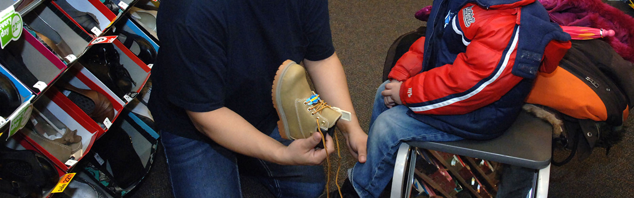 Child receiving winter boots