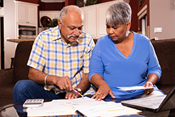 couple going over bills to be paid