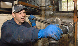 man fixing heating systems