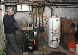 men repairing heating systems