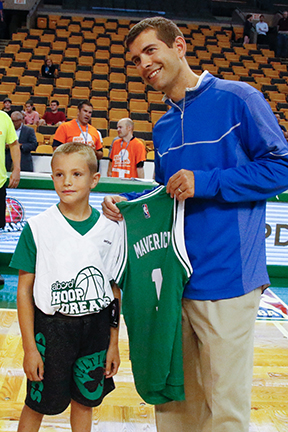 young child taking part and receiving a jersey at the ABCD Hoop Dreams