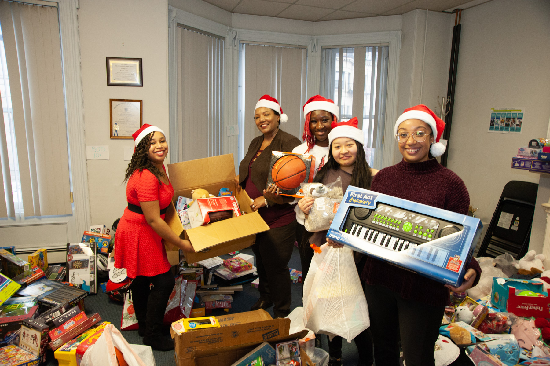 ABCD South End staff and volunteers give toys to neighborhood kids in need through toy drive