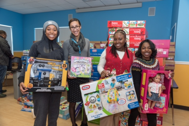 ABCD staff sorts donated gifts for holiday toy drive