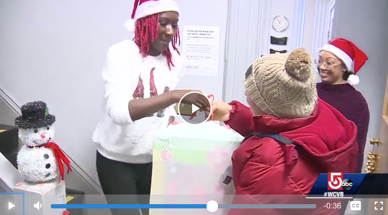 "ABCD staff ""elves"" give toys to a South End neighborhood mom."